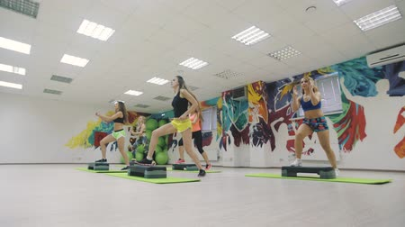 step : Women group in aerobics class.