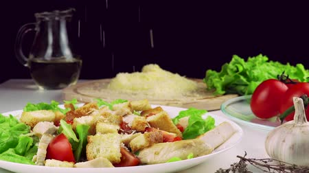caesar : grated parmesan falling onto caesar salad in slow motion Stock Footage