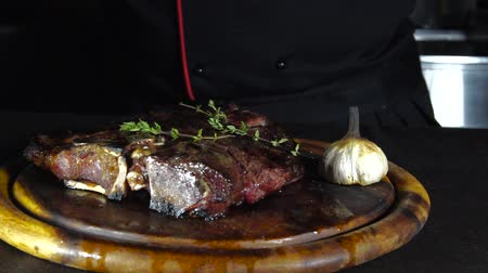 wagyu : fried steak on the grill lies on a wooden board with vegetables