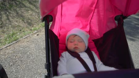 smoczek : Sweet little baby boy sleeping in stroller Wideo