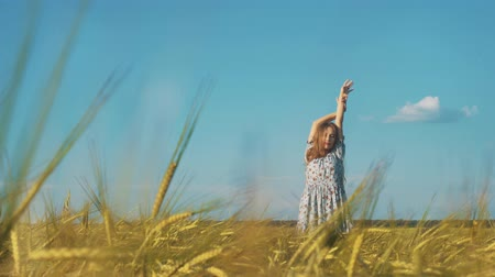 fall down : Beauty Girl with Healthy Long Hair Outdoors. Happy Smiling Young Woman falling down on the grass. Stock Footage