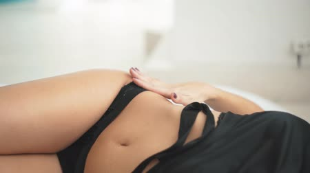 Beautiful girl in the black underwear, abdominal features. Wideo