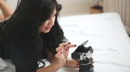Sensual woman takes a photo of an new camera Wideo
