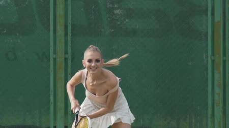 seductive : Sexy tennis girl posing at the camera