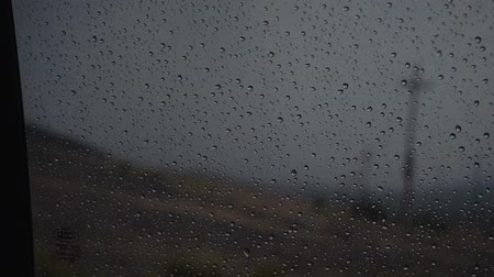 mosqueado : Rain drops on the window with mountain in background