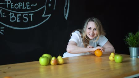 rejoice : girl playing with fruits on table.