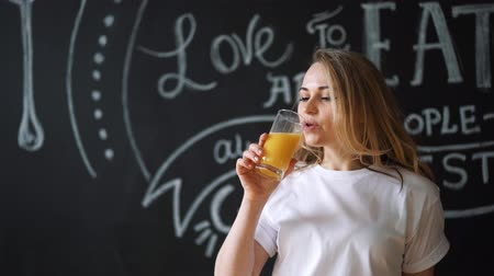 antioxidant : Young beautiful woman drinking juice, girl drink orange fresh on morning breakfast
