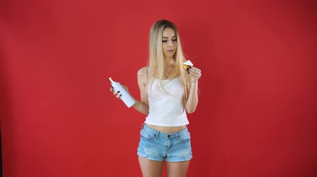 turmix : the girl is eating whipped cream in a bottle
