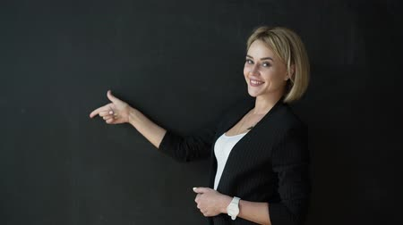 indicating : The teacher hand gesture, showing a blank Board Stock Footage