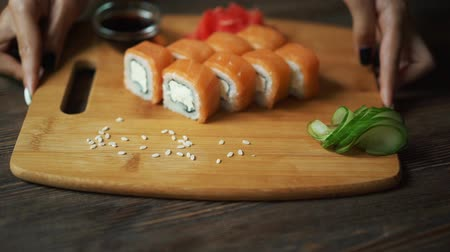нигири : Fresh sushi, rolls on the table. Dark background. Sushi sticks.