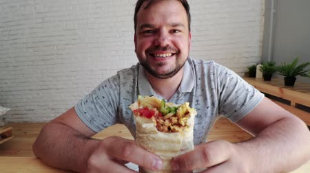 donner : Man eating Doner Kebap its a midlle eastern fast food cuisine