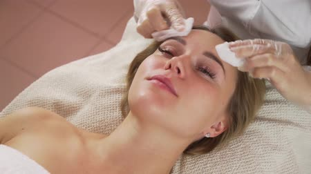 bőrápolás : Woman getting rf lifting in her face in clinic. Anti-aging RF-therapy, rejuvenation and lifting procedure.