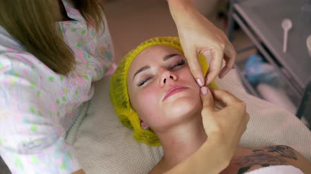 masaż twarzy : Girl having facial massage. Removes the second chin, corrects ptosis