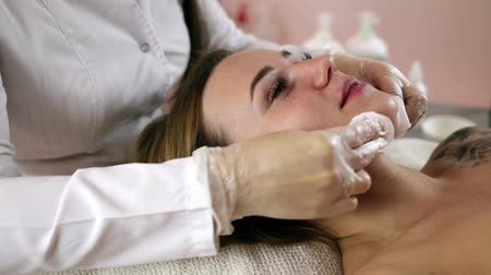 apparatus : Woman getting rf lifting in her face in clinic. Anti-aging RF-therapy, rejuvenation and lifting procedure.