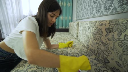 housekeeper : Service cleaning dirty sofa and chair with a special tool, detergent is applied. Cleaning with professional tools