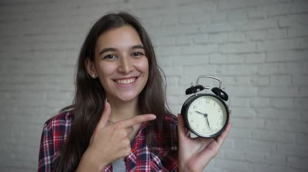 Young girl holding vintage clock Стоковые видеозаписи