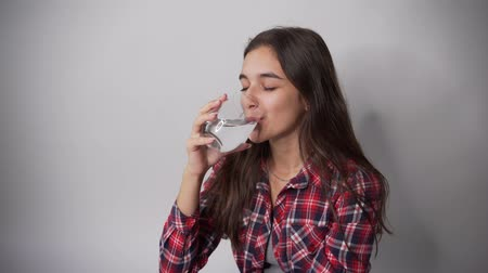 Girl drinking clean water from a glass