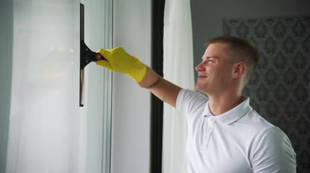 sanitize : A man from a cleaning company washes Windows