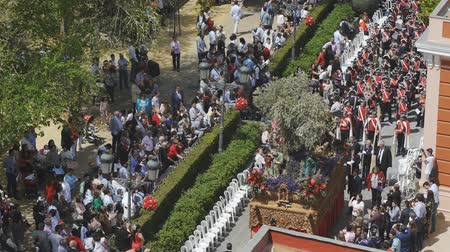 clergy : CIUDAD REAL, SPAIN - APRIL 14, 2017: Raising holy sculptures in Prado gardens during day procession of Holy Week Semana Santa . Top view.