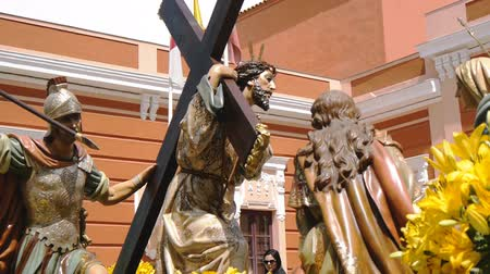 clergy : CIUDAD REAL, SPAIN - APRIL 14, 2017: Passing of sculptures of Jesus carrying cross and roman soldier with spear in Prado gardens during day procession of Holy Week Semana Santa .