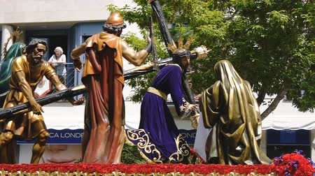 ciudad : CIUDAD REAL, SPAIN - APRIL 14, 2017: Passing of Maundy Thursdays sculptures during day procession of Holy Week Semana Santa . Stock Footage