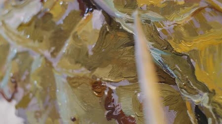 정물화 : Close-up of painting process. The small brush makes smears of oil paint on the still-life painting on canvas. 무비클립