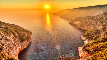 görögország : Beautiful full HD HDR timelapse video of a summer sunset of the rocky coast of the island of Zakynthos, Greece.