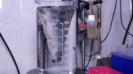Measuring cylinder with a solution on a magnetic stirrer in a laboratory