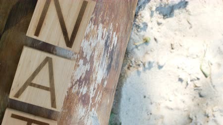 The word nature is laid out in wooden letters