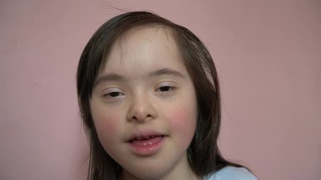 Cute smiling down syndrome girl