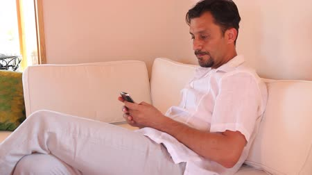 düşünceli : sad man using a phone, in the living room