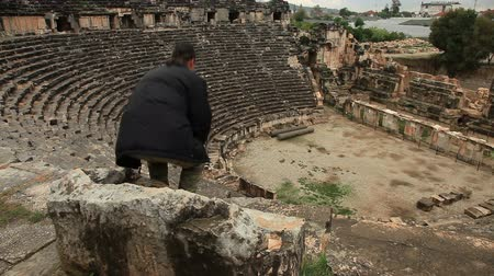 old times : Tourist man visiting ancient  amphitheater at Myra