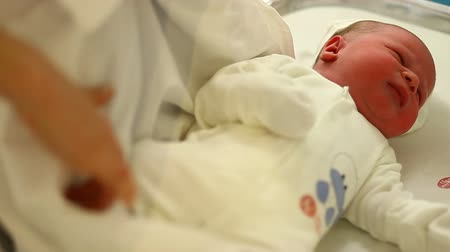newborn child : newborn in hospital room