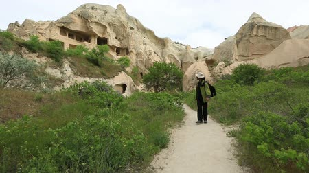travertine : Tourist watching cave house Famous city  Cappadocia
