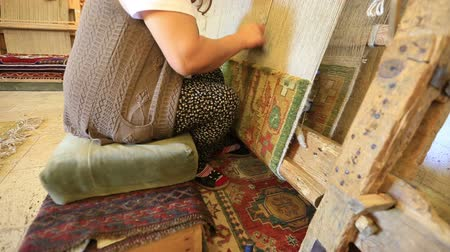industry : Woman weaving a carpet