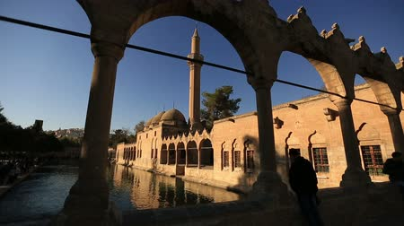turecko : holy travel destination fish lake and Halil-ur Rahman Mosque, wide angle pan shoot,