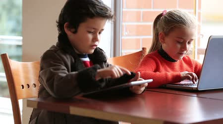 alapfokú : smart children studying, using digital tablet and laptop at classroom