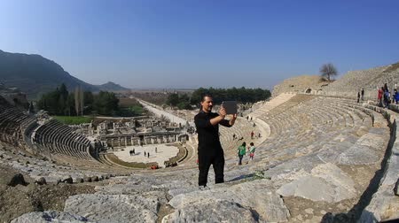 kamień : tourist taking photo with digital tablet in amphitheather of ancient Ephesus Turkey
