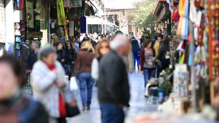 bazar : tourist walking shopping street in bazaar Athens Greece