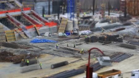 montáž : tilt shift effect time lapse construction zone with heavy equipment and workers (miniature effect), dolly shot Dostupné videozáznamy