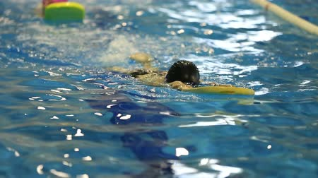 sport dzieci : little child training in swim pool