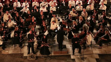 clarinet : time lapse conductor performance in symphony orchestra at historic amphitheather Stock Footage