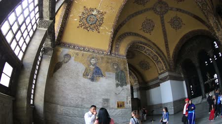 музей : Tourist Visiting Historic Famous Monument Hagia Sophia Church Mosque (Aya Sofya) at SultanAhmet District Istanbul Turkey