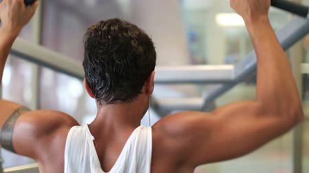 tornaterem : attractive young man exercising in the gym