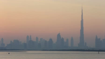 ночная жизнь : view of Dubai skyscraper and Burj Khalifa at sunset United Arab Emirates UAE