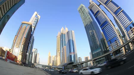 эмираты : city traffic with skyscraper in Dubai United Arab Emirates UAE Стоковые видеозаписи