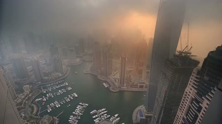 эмираты : aerial view skyscraper foggy weather Dubai Marina at United Arab Emirates UAE