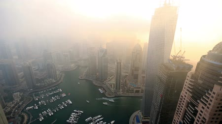 enevoado : aerial view skyscraper foggy weather Dubai Marina at United Arab Emirates UAE
