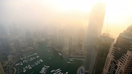 эмираты : time lapse aerial view skyscraper foggy weather Dubai Marina at United Arab Emirates UAE