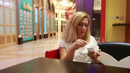 lunch : Woman in  Depression,  eating ice cream Stock Footage